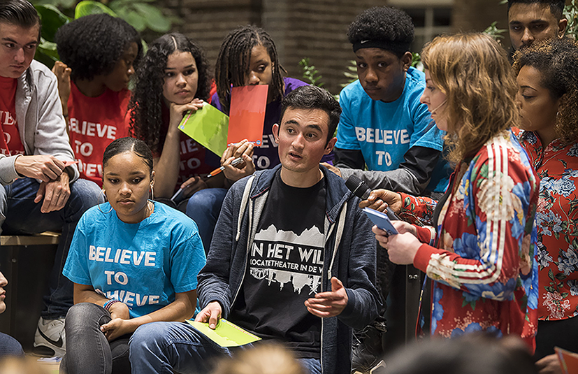 Young people discussing during a public initiative